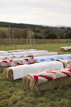 Hay bay ceremony seating with rustic ladder wedding arch.