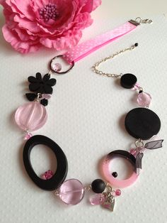 Rose Limonade Jewlery on Etsy - Sweet Daisy necklace made of pink and black ribbons with resin, wood, glass and agathe beads with a silver heart charm.