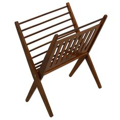 """This is a slim, American-made, Mid-century Modern folding magazine rack crafted of sleek walnut. One side of the rack has horizontal dowels and the other side has a flat surface pierced by elongated ovals. Easily transportable. Easy to reach from your chair or bed because it sits up on legs, and easy to see your reading material due to the open design. Closed, the piece measures 11""""."""