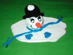 Snowman's head on a melted puddle of white crochet. ~ free pattern