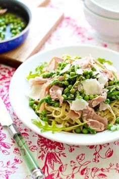 Pasta gets oh so great with spring peas and salty prosciutto. Don't forget to top with heaps of shave Parmesan cheese!