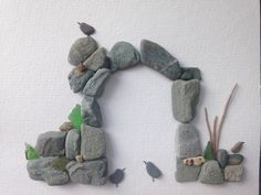 Old Castle Archway. Pebbles, sea glass, shell and driftwood . Birds. Picture. Sold