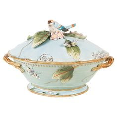 Earthenware tureen and ladle set with a garden-inspired motif and perched bird accent.Product: Tureen and ladleConstr...