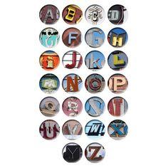 Set of twenty-six coasters with alphabet motifs.    Product: 26 Piece coaster setConstruction Material: Melamine