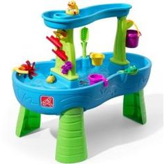 Children will enjoy backyard play time while developing their fine motor and sensory skills with the Rain Showers Splash Pond Water Table. Kids scoop up water from the pond and pour in the top tier to make a showering splash below. Best Water Table, Water Table Toy, Sand And Water Table, Step 2 Water Table, Water Table For Kids, Water Play For Kids, Kids Sand, Bateau Pirate, Backyard Play