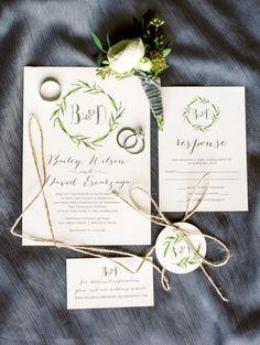 Elegant wreath inspired wedding invitations: http://www.stylemepretty.com/little-black-book-blog/2015/12/28/elegant-antique-art-bar-wedding/ | Photography: Dana Fernandez - http://www.danafernandezphotography.com/