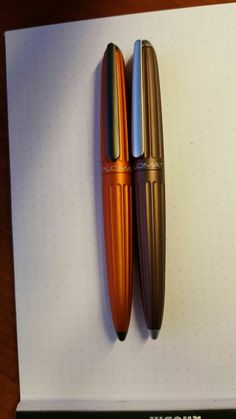 Diplomat Aero Orange and Brown. Gold nib...beautiful fountain pen.