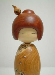 Beautiful kokeshi: looks like pen and ink with raised acrylic paint detail