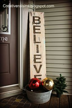 Believe sign and galvanized bucket with giant ornaments and greenery...love this for the front step!!