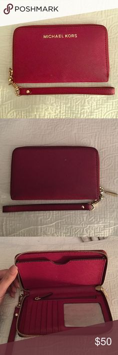 Micheal Kors Wristlet/ Wallet Small burgundy Micheal Kors Wallet. Gently used but in great condition. A couple little white dust spots but nothing that can't be cleaned. Michael Kors Bags Wallets