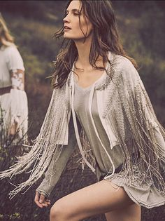 Starry Night Capelet | Intricately beaded capelet featuring fringe beading detail and stitched embellishment throughout. Drapes over the shoulders and features a tie-front closure.