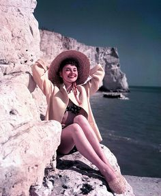 Audrey does summer right: straw hat, azure ocean & a smile. my kind of sunshine.