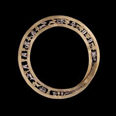 Gold bangle with gold and silver amulets   Egypt, Middle Kingdom, 1991-1785 B.C.  The British Museum