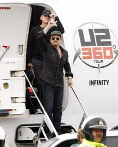 U2 ~ 360 Tour, the Infinity plane.  Bono with Larry behind him.