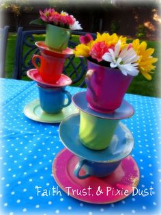 tea cup centerpiece- Either a little girls birthday or a Mad Hatters Tea Party theme.... Garden Party Delights!