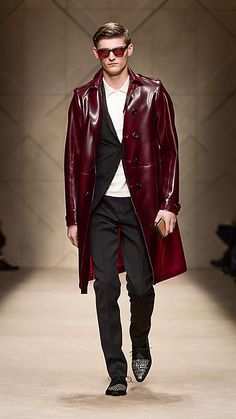 Burberry - Oxblood.  A trench coat in velvet-finish rubber. The coat features raw edges and is unlined for a translucent appearance. Heritage details include epaulettes, cuff straps and a  buttoned back vent. 100% PVC Sponge clean Made in Italy