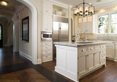 Love the dark chandelier and brushed nickel cabinet hardware cup pulls and knobs