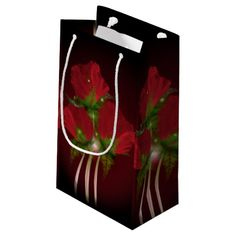 """Poppies on Black Small Gift Bag  Artwork designed by karlajkitty. Made by Digiwrap. Sold by Zazzle.  Fractal Poppies all around the bag.  Shown on a black background.  Click on the """"Customize"""" button for more options.  Artwork and design by Karlajkitty"""