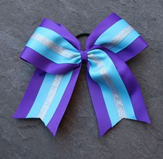 Want to learn how to make a layered Cheerleading Bow. Click here now to follow our Cheerleading Bow Instructions.
