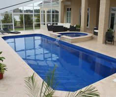 The best fiberglass swimming pools in the Daytona Beach, FL region. The best designs and colors to choose from. Contact us to learn more and get into a pool today! Fiberglass Pool Cost, Fiberglass Swimming Pools, Swimming Pool Sales, Swimming Pool Designs, Pool Contractors, Pool Shapes, Pool Picture, Pool Installation, Backyard Pool Designs