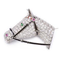 Pavé diamond set horse head brooch in platinum with a black enamel bridle, a…