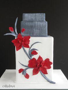 3 tier wedding cake including double barrel tier, splash of red - sugar flower