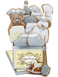"""COOKIES IN LIMITED-EDITION TIN Buy It Now: £43.50 for tin with 16 handmade biscuits at Biscuiteers Sweet! Shaped like booties, blocks and buggies, Biscuiteers's vanilla biscuits (we call them """"cookies"""" on this side of the pond) #royalbaby"""