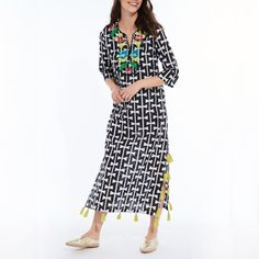 Our boho chic lightweight Quetzal Aru Long Black Kurta from Roberta Roller Rabbit is perfect for your winter getaways. Accented with embroidery and tassels.