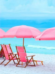 Pink umbrella and chairs on the beach