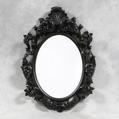 This large black oval Rococo decorative mirror is stunning and perfect as an unusual and quirky over-mantle mirror It would be great in a reception or as decoration for your wedding