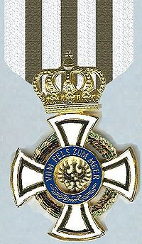 Friedrich Friedrichs had already been awarded the Knight's Cross with Swords of the Hohenzollern House Order.   He had also been recommended for the Pour le Merite. Reportedly, it was awarded on 20 July, five days after his death. However, the rolls of the order do not list him as a recipient. The decoration was an order of chivalry of the House of Hohenzollern awarded to military commissioned officers and civilians of comparable status.