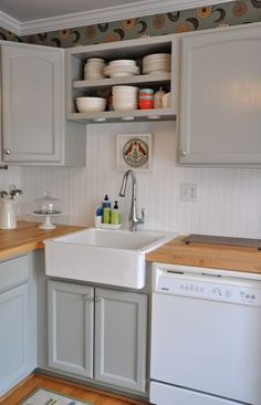 """gray cabinets, butcher block countertop - Bead board backsplash. Instead of funky wall paper above the cabinets look at pressed tin or an embossed """"tin"""" wall paper."""