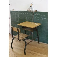 chalkboard with old school desk