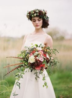 20 Wedding Bouquets with Feather Details | SouthBound Bride www.southboundbride.com/20-wedding-bouquets-with-feather-details  | Credit: Paula O'Hara/Pearl & Godiva/Frog Prince via Wedding Sparrow