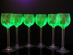 Wine glasses made of uranium glass http://en.wikipedia.org/wiki/Uranium_glass