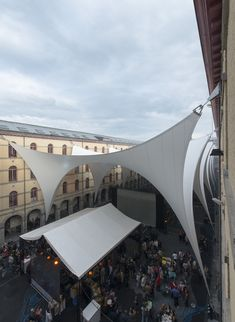 Image 14 of 29 from gallery of Covering of the Courtyard Carré des Arts in Mons / AgwA + Ney & Partners. Photograph by Marie-Françoise Plissart Fabric Structure, Shade Structure, Architecture Office, Architecture Design, Sail Canopies, Membrane Structure, Tensile Structures, Sun Sail Shade, Courtyard House