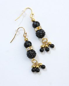 Vi Bella Jewelry - Claudia Earrings – Elegance to the core! The Claudia Earrings consist of an elegant array of beads: black textured beads, black multifaceted beads, rhinestone bejeweled gold beads, and small accent beads in black and gold. Pairs perfectly with the Claudia Necklace.     Length:  2 Inches     Handcrafted by Vi Bella Artists in Haiti.  $16.95