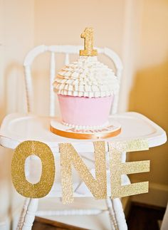 Highchair decorating idea for 1st birthday featuring pink and sparkling gold.  See more first girl birthday party ideas at www.one-stop-party-ideas.com