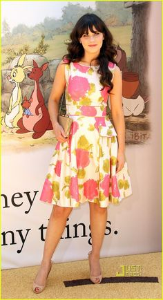 """'Winnie The Pooh' Premiere!   Disney Studios, Burbank, CA 2011.  Zooey Deschanel wears kate spade new york. The 31-year-old actress & singer wrote & performed the song """"So Long,""""  The playful, summery, sleeveless floral wynne dress suit's Zooey's style.  Complete with ostrich-embossed Victoria falls Samira clutch & beige open toe pumps."""