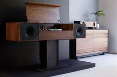Symbol Modern Record Console with Hand-Wired Tube Amplifier | Cabinet made of solid American walnut and the sculptural base is made of hand-patinated plate steel | Symbol Handcrafted Audio