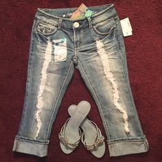 """NWT Jr.s distressed cropped JEANS Junior's ALMOST FAMOUS brand destroyed cropped denim with studded, rhinestone and embroidered back pockets. Cuffed hem. NEW WITH TAGS. 18 1/2"""" inseam (length) ....juniors size 5. 60% cotton, 39% polyester, 1% spandex. Sassy, perfect for SPRING       NO TRADES.NO PAYPAL. Almost Famous Jeans Ankle & Cropped"""