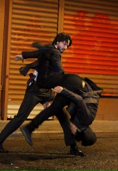 Keanu Reeves kicks ass in John Wick 2 set pics and video. See them here