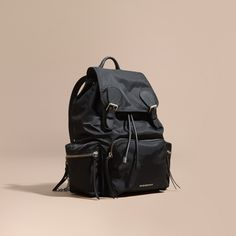 1dd27638390c A lightweight showerproof rucksack with cushioned canvas and polished metal  chain shoulder straps and leather trims. Inspired by the fabric of the  Burberry ...