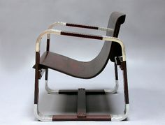 Giuseppe Pagano Pogatschnig (1896 - 1945)  Armchair and two side chairs , Milan 1930's  Aluminum, stained beech and plywood