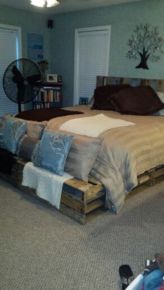 Pallet bed made just from pallets.  Extremely easy.  And if you don't have a king size bed you can cut the pallets down.  So pretty.