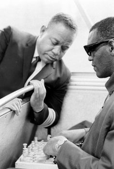 Ray Charles and the captain of his Martin 404, playing chess in a bus, on May 7, 1966. Photo by Bill Ray.