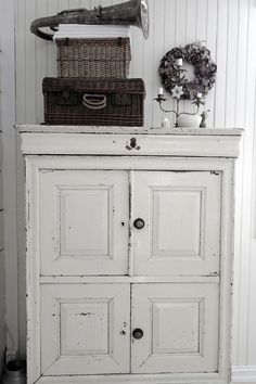 """TG: Could totally make this out of a couple of small """"above refrigerator"""" cabinets from the Re-use it center, add a top and some feet and wah~la!"""