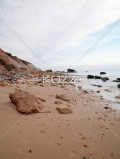 image of rock at beach. - Scenic image of rock at beach.