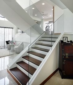 "Free standing glass panels (no handrail?) on ""floating"" stair example.The Interior Place (S) Pte Ltd"