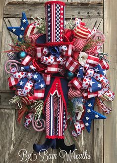 Patriotic Wreath, Patriotic Decor, 4th Of July Wreath, 4th Of July Decor, Americana Wreath, Americana Decor, Uncle Sam, Uncle Sam Wreath, Summer Wreath, Memorial Wreath  Get Ready~ Hes Amazing~ Uncle Sam!!!!  Wow and Wow~ did I say Wow!!!! This one is phenomenal! Measuring XXL at 35 inches~ this Patriotic wreath is a dream! Filled with high gloss mesh, burlaps, designer ribbons, lush greens, Scarlett red roses, patriotic sprays, an American flag stars and let me not forget the star of the…